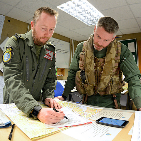 Two Pilots looking at a map