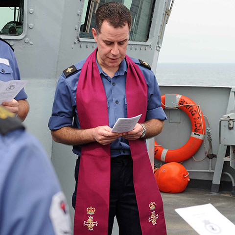 A Royal Navy Chaplain giving prayer