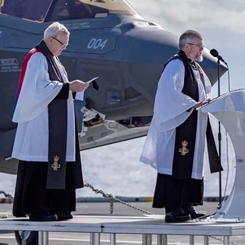 Two Chaplains conducting a service