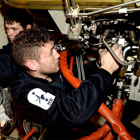 A Royal Navy Advanced Apprenticeship Marine Engineer at work