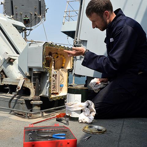 A Royal Navy Advanced Apprenticeship Weapon Engineer at work