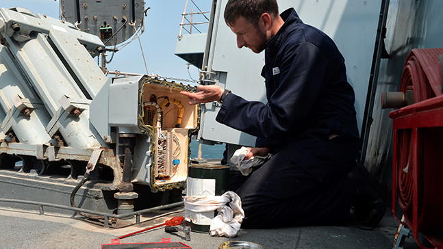 An Advanced Apprenticeship Weapon Engineering rating working on Royal Navy kit.