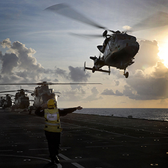 Royal Navy personnel on flight deck.