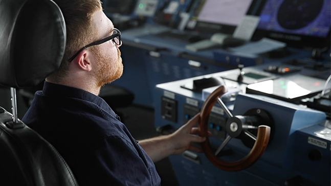 Seaman at the helm of a ship