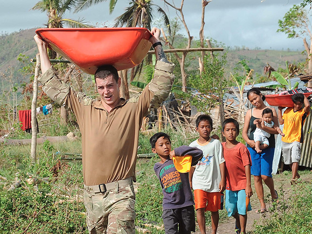 Royal Navy personnel delivering humanitarian aid.