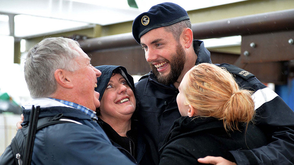 Returning Royal Navy personnel greeting their family.