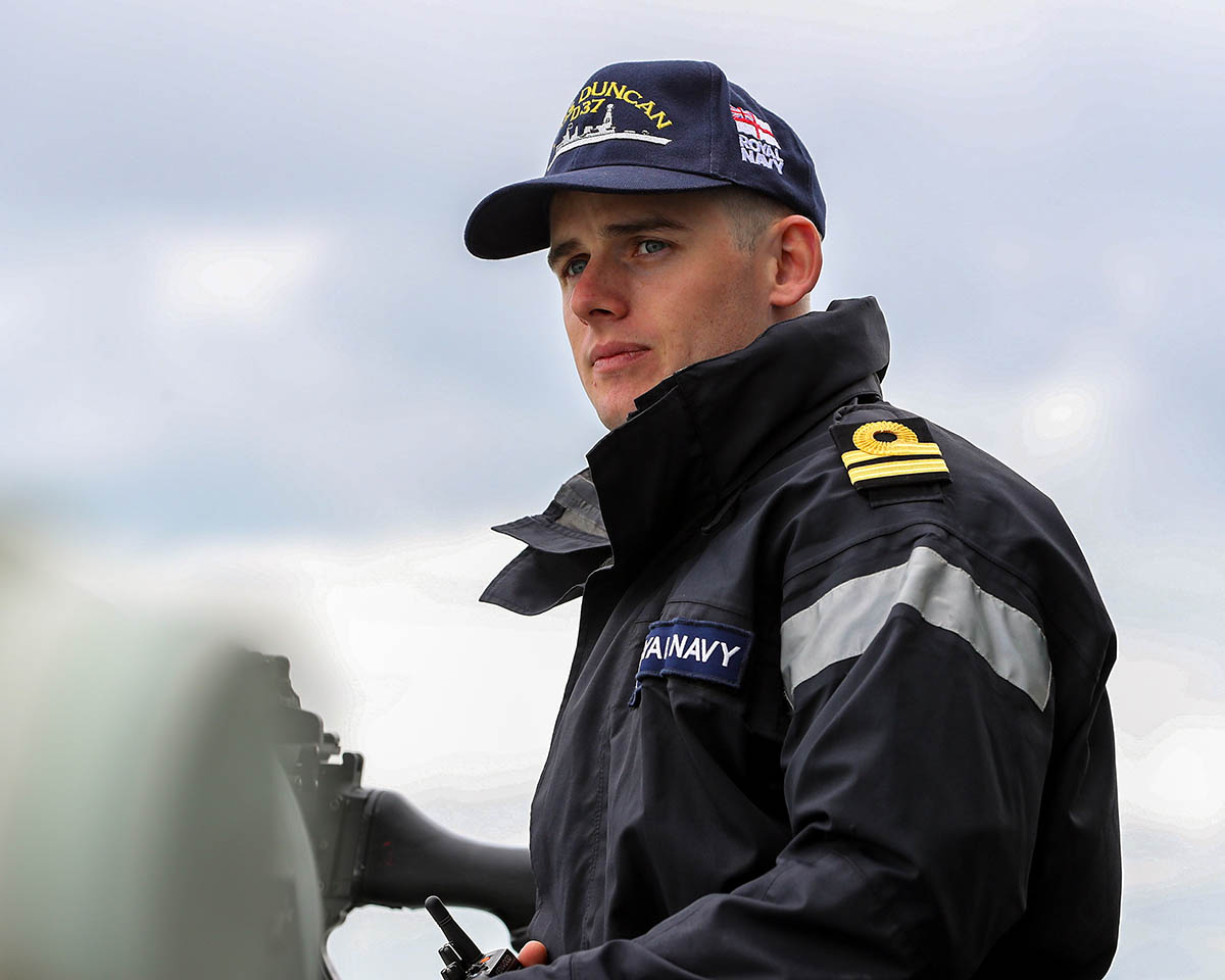 Fighter Controller 1 (FC1), Lt Raeside, on the bridge wing of HMS Duncan.