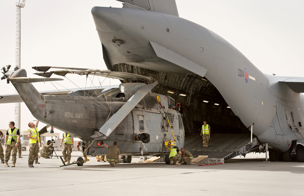 One of the Sea King helicopters being loaded onto a C17