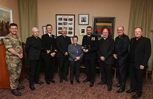 The Moderator joins Naval Chaplains and military personnel at HMNB Clyde.  L-R: Colonel Tony De Reya, Commanding Officer of 43 Commando Fleet Protection Group Royal Marines; Reverend Dr Marjory MacLean, Convener of the Chaplains to Her Majesty's Forces Committee of the Church of Scotland; Commodore Donald Doull, Naval Base Commander Clyde; Reverend Mark Allsop, Padre to 43 Commando; The Right Reverend Susan Brown, Moderator of the General Assembly of the Church of Scotland; Reverend Mark Dalton, HMS Neptune Chaplain; Venerable Martyn Gough QHC, Chaplain of the Fleet; Reverend Professor Scott Shackleton, Deputy Chaplain of the Fleet; and Father Michael Maloney, Naval Base Roman Catholic Officiating Chaplain to the Military.