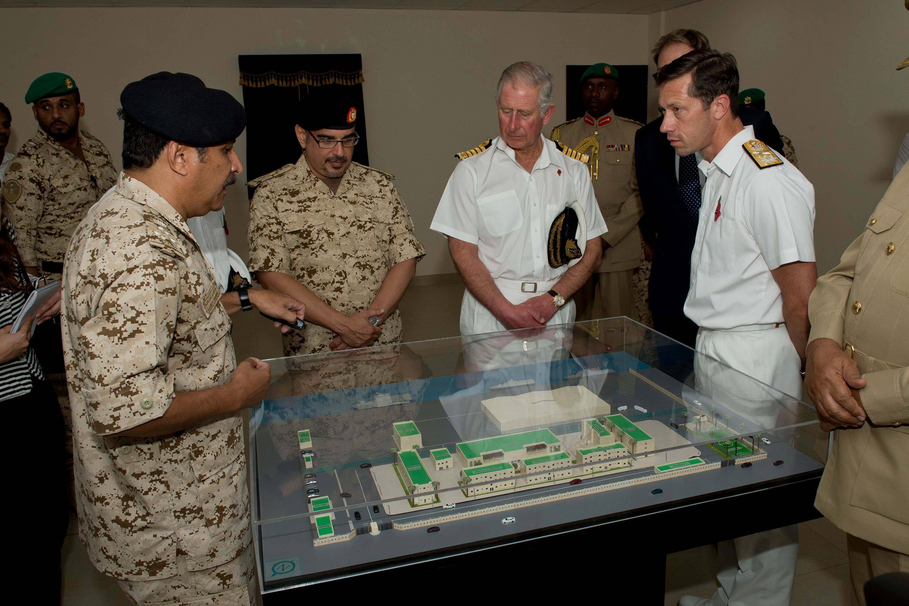 Brigadier Abdu lAziz, director of the Ministry of Military Works, left, briefs His Royal Highness Prince Salman bin Hamad bin Isa Al Khalifa, Crown Prince of Bahrain, centre left, HRH The Prince of Wales and Commodore William Warrender, right, on the layout of the site. Picture: PO G Granger US Navy