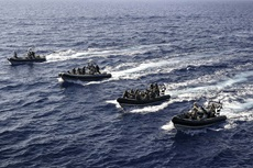 Royal Marines and Cypriot marines form up in four fast boats