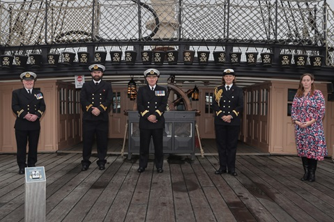 Commodore David Eagles (centre) with his staff aboard HMS Victory