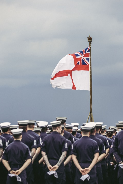 HMS Albion's White Ensign billows in the Med during the flight deck service