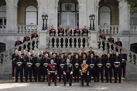 Band of HM Royal Marines Collingwood pose for a formal portrait outside the museum