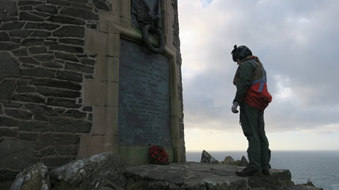 A crew member from 814 NAS at the monument on the Isle of Islay