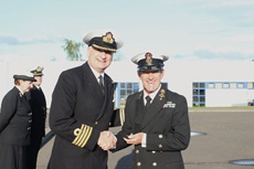 CPO Henry Gibson receiving the first clasp to his Volunteer Reserves Service Medal from Captain Nick Dorman