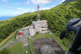 An 815 NAS Wildcat prepares to land at Montserrat's volcano observatory