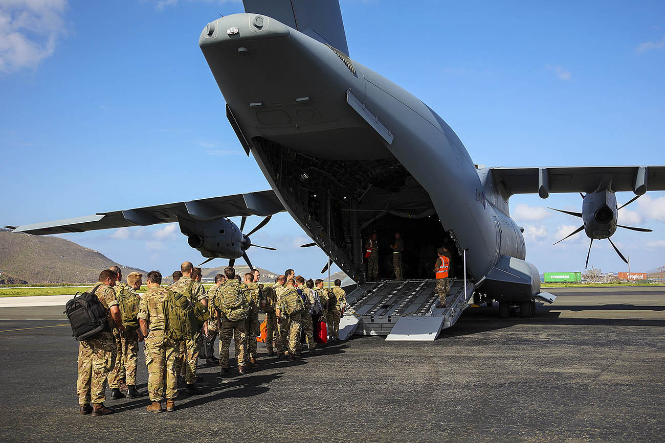 Mission complete: Royal Marines fly home after month-long Caribbean clear-up operation