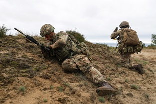 A Royal Marine from Zulu Company. 45 Commando changing a magazine while in cover during the section attack training.