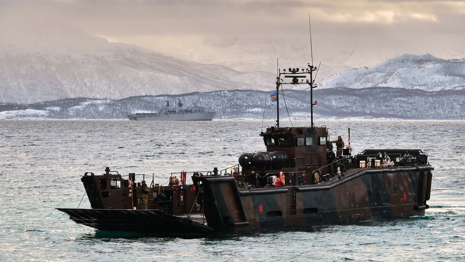 Royal Marines move their vehicles ashore after disembarking from HMS Albion. Picture: POPhot Si Ethell