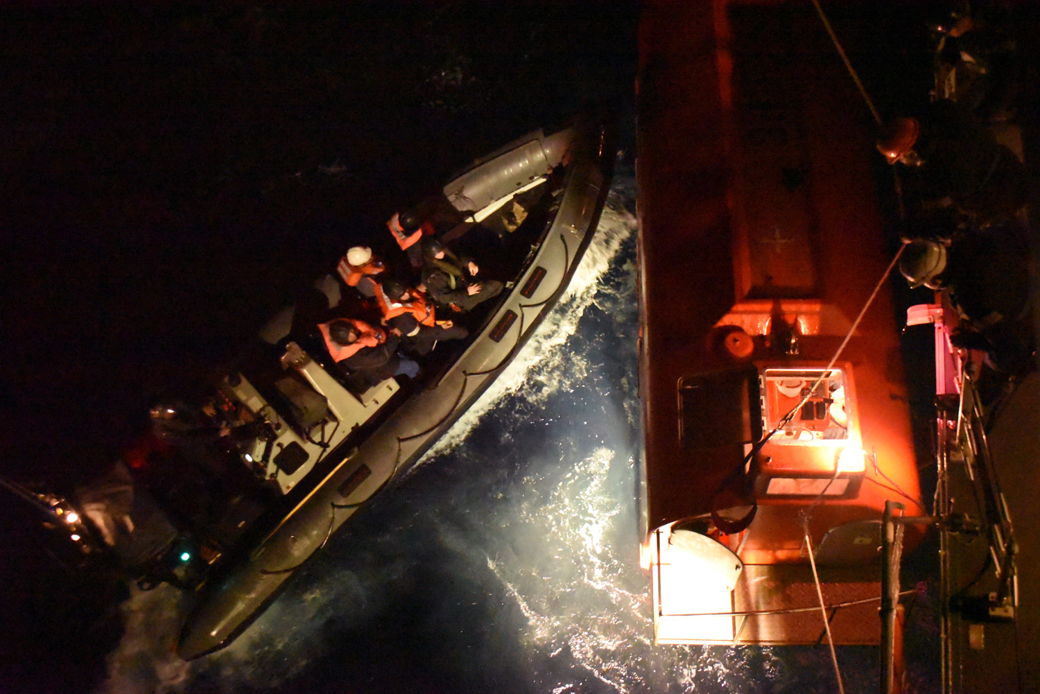 HMS Argyll's sea boat pushing the lifeboat to safety.