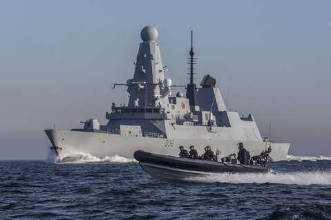 HMS Defender and one of her sea boats