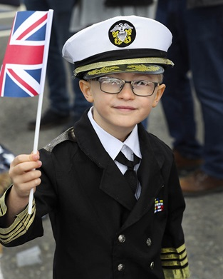Owen Ellaway dressed up in Naval attire awaiting the return of his father on HMS Diamond.