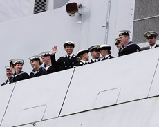 Some of the officers and crew of HMS Diamond waving to their families as they return to Portsmouth.
