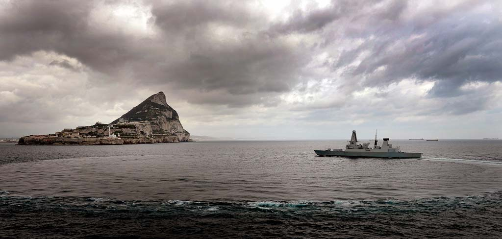 Aerial image of Dragon conducting a sovereignty patrol with Gibraltar, her first foreign visit, in the background.