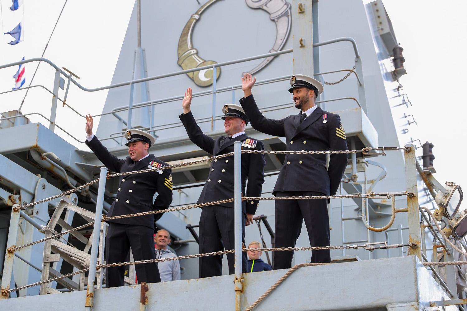 Officers on HMS Echo waving to the crowds.
