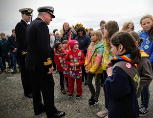 Commodore Lett chats with Falklands youngsters after the Battle Day Ceremony