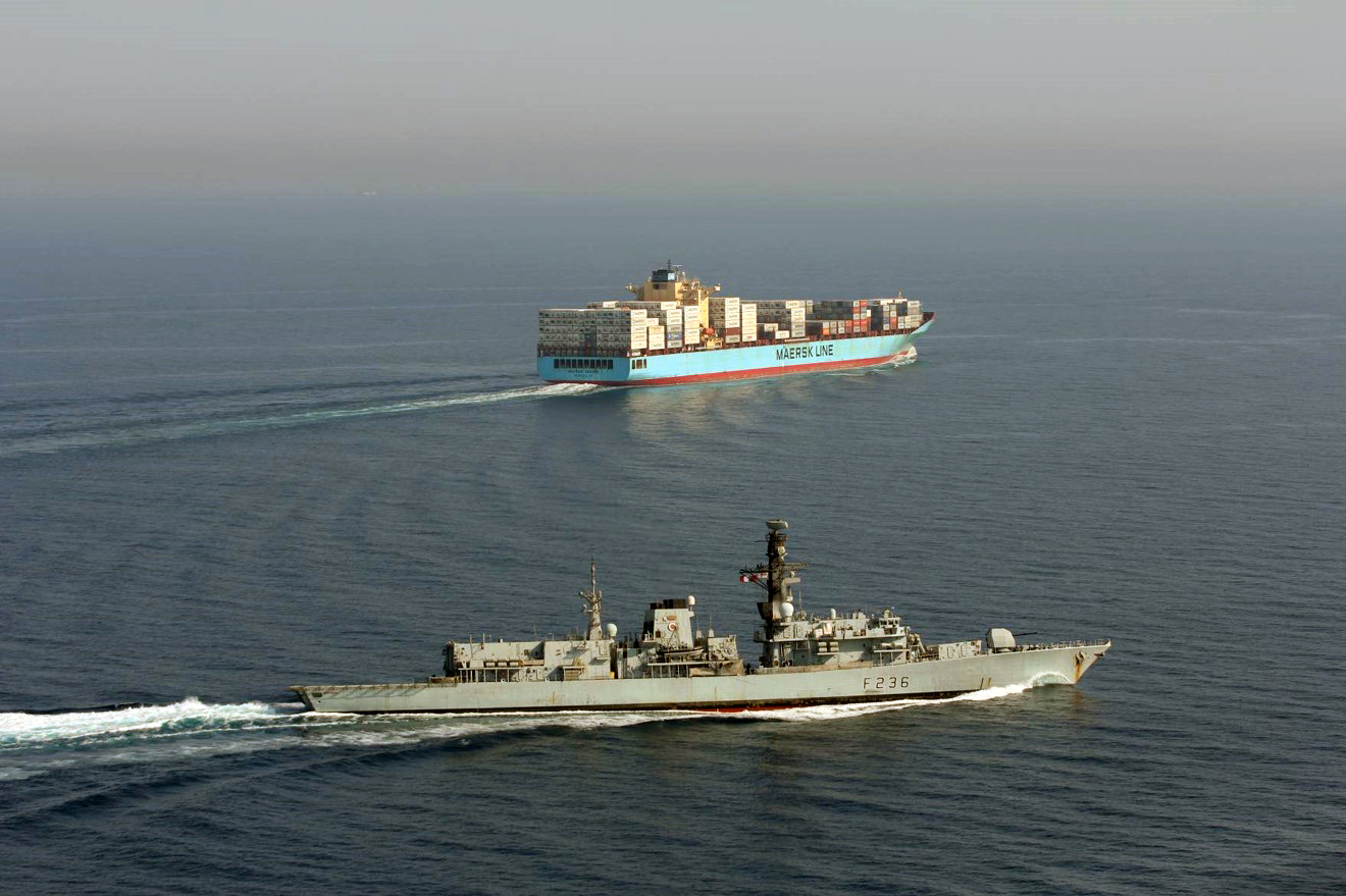 HMS Montrose shepherds a container ship in the Gulf