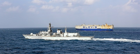 HMS Montrose accompanies a car carrier in the Gulf