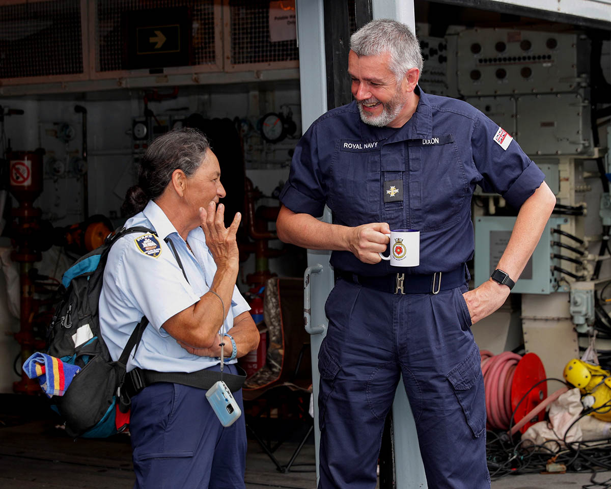 Navy Chaplain Peter Dixon speaks to Pitcairn Police Officer Mrs Christain on board HMS Montrose