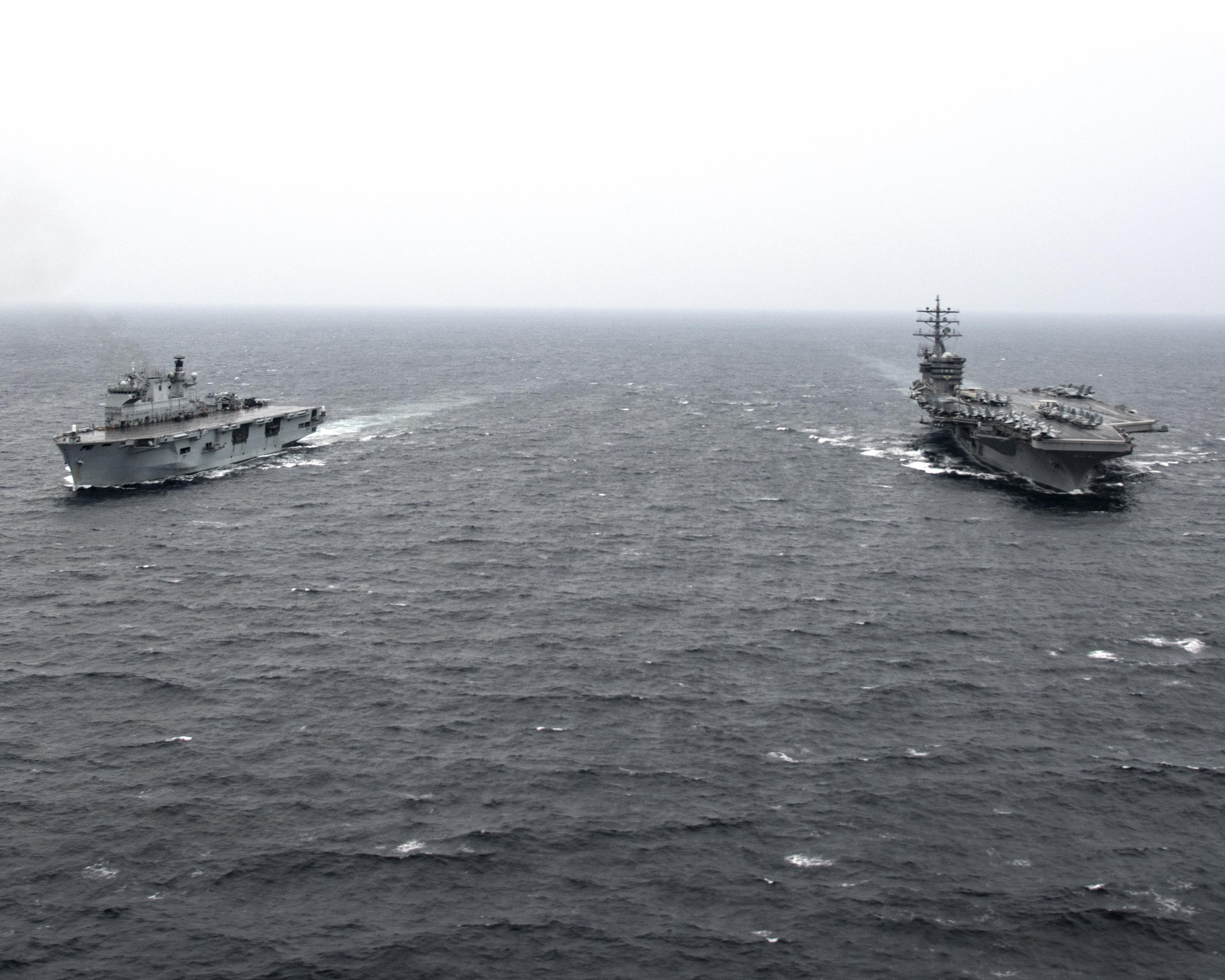 HMS Ocean, left, and USS Dwight D Eisenhower transit the Gulf. Picture: US Navy