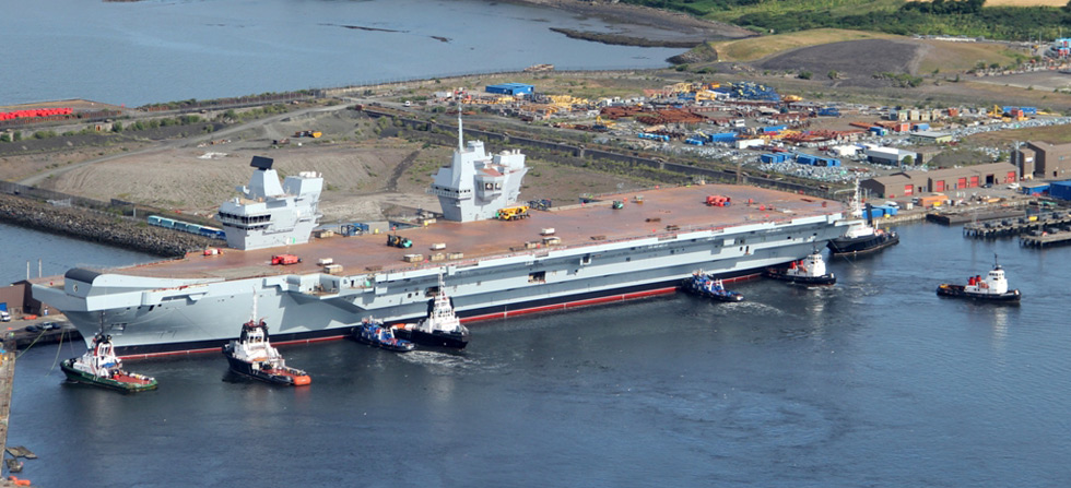 HMS Queen Elizabeth takes to the water as new carrier is ...