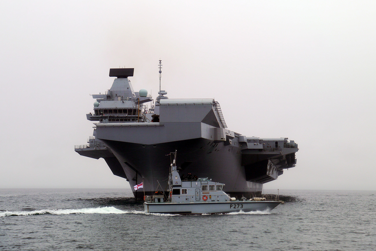 'Grey dwarf' as tiny patrol boats are overshadowed by gigantic HMS Queen Elizabeth