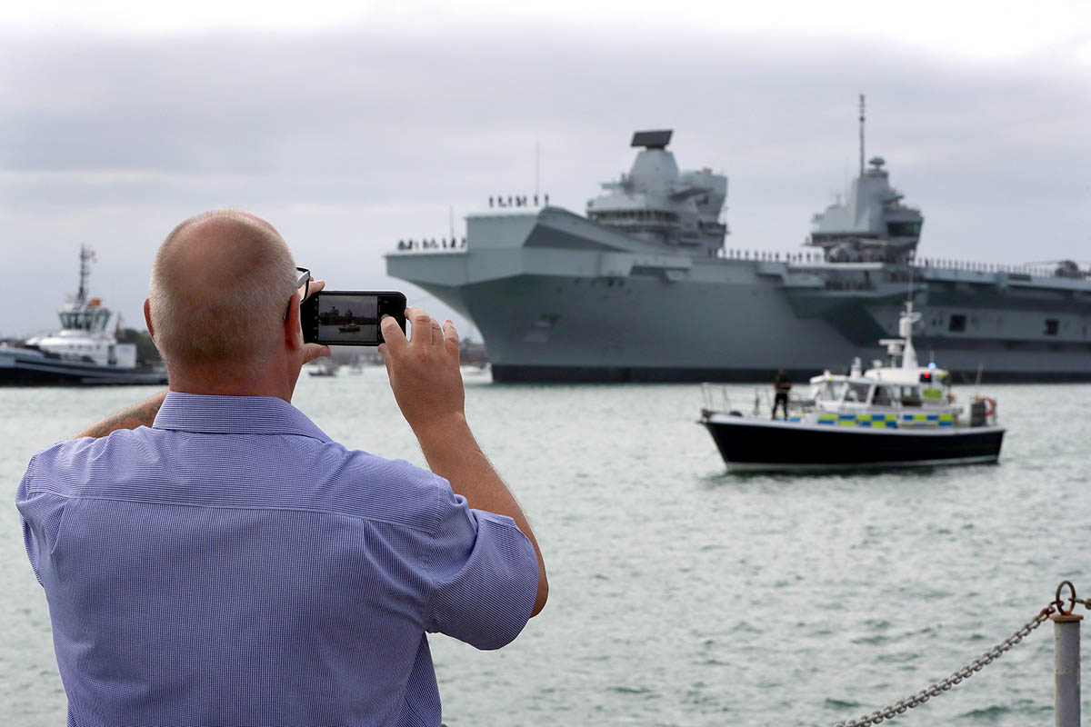 HMS Queen Elizabeth, departs her home port of Portsmouth bound for the USA to land fast jets on deck for the very first time.