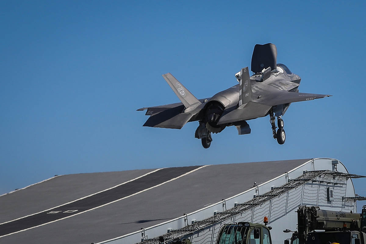 Royal Navy pilot Commander Nathan Gray makes the first ever F-35 Lightning jet take off from HMS Queen Elizabeth