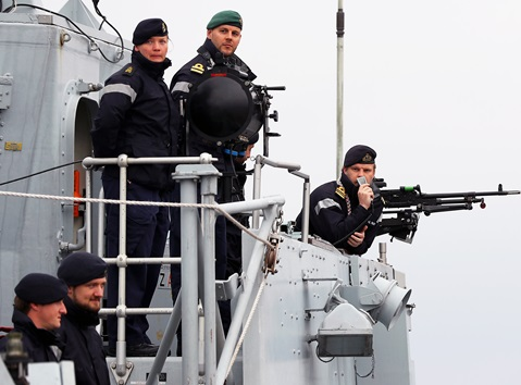 Crew members from HMS Ramsey prepare to berth alongside HM Naval Base Clyde following their NATO deployment