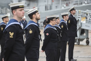 Members of ship's company welcome HMS Spey alongside