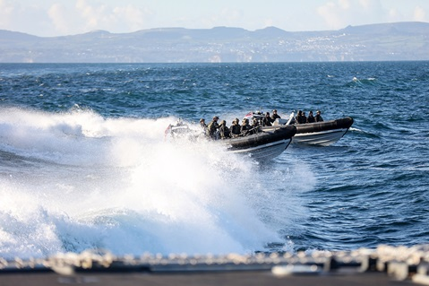 The boarding and search team races through Plymouth Sound at high speed in two RIBs