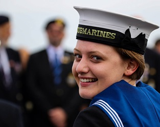 A submariner smiles back at the camera as she takes part in the Freedom of Anglesey parade