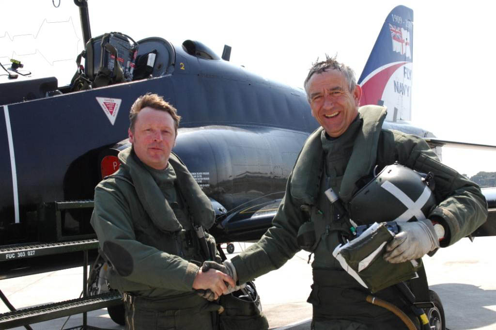 Lt Cdr Tim Taylor, (Left) being congratulated by 736 NAS Chief Pilot Nigel Wharmby