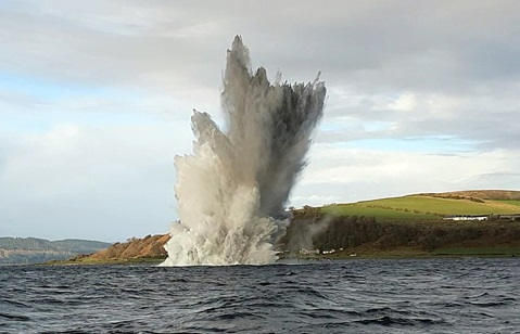 A huge plume of water and mud as the mine is blown up off Bute