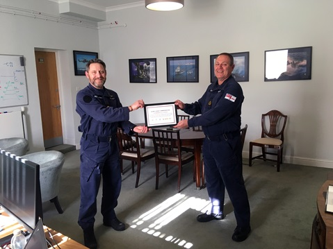 FOST Cdre Andrew Stacey (left) presents CPO Kevin Hewson with his certificate
