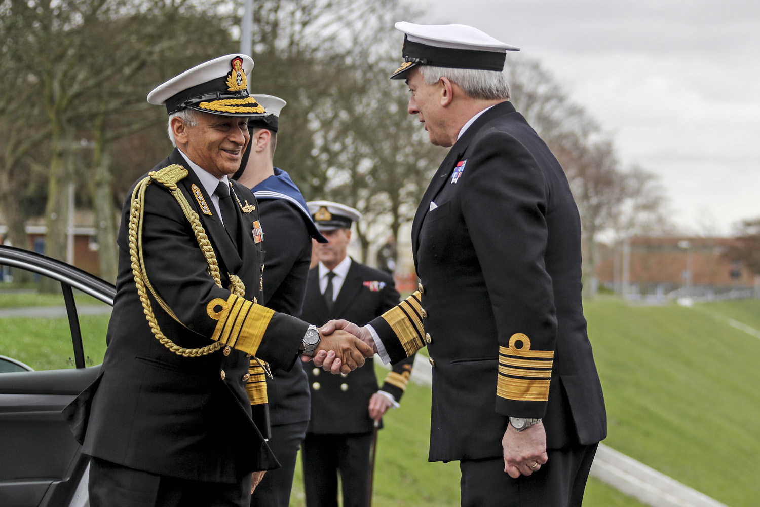 The Chief of the Indian Naval Staff Admiral Sunil Lanba being greeted by The Chief of Naval Staff, The First Sea Lord Admiral Sir Philip Jones KCB ADC RN