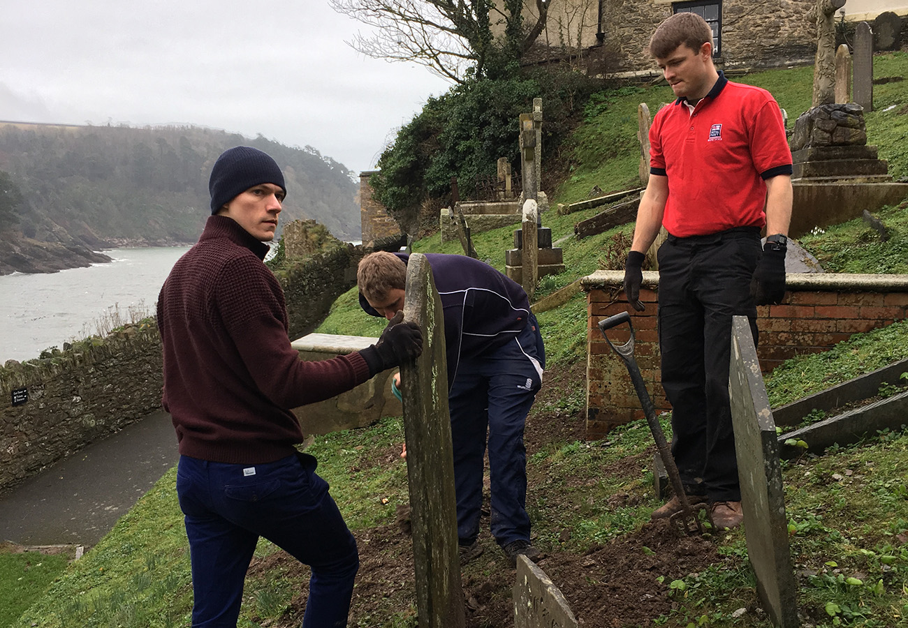 Budding naval aviators help to spruce up local church grounds