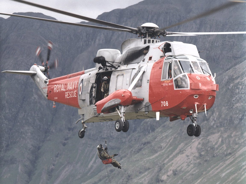 Gannet aircrewman being winched from helicopter