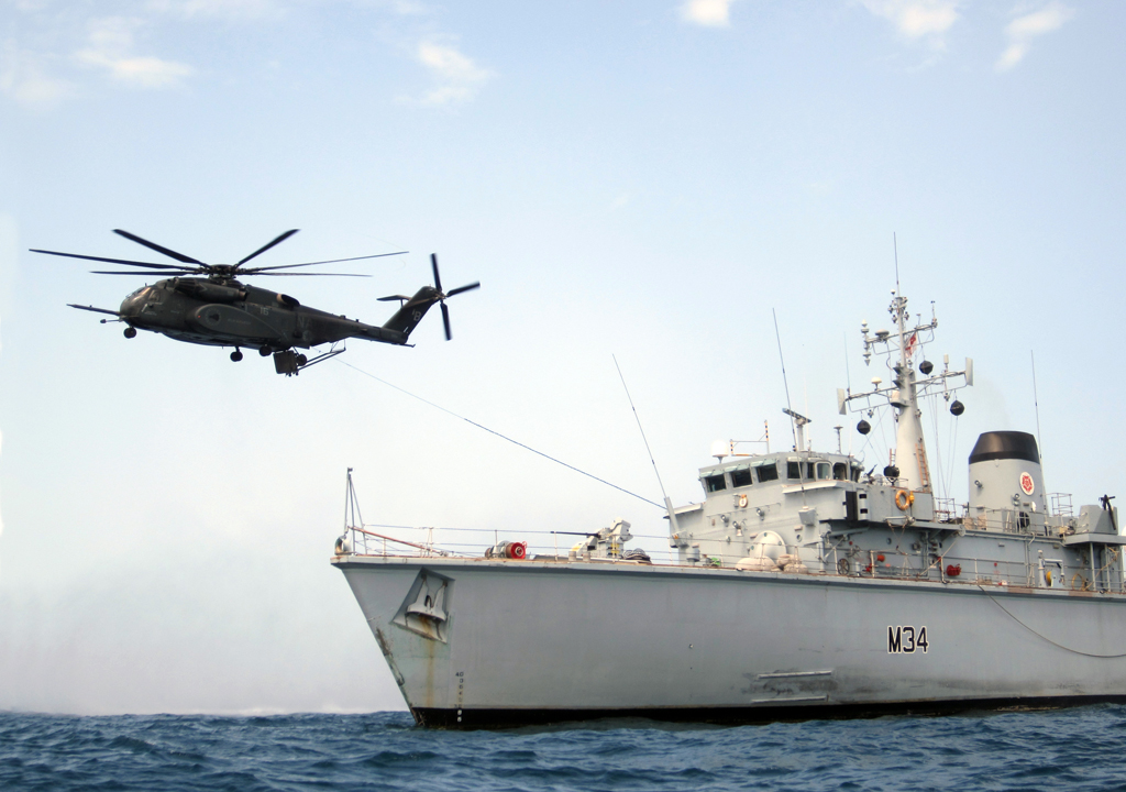 HMS Middleton conducting winching drills with a US Navy Sea Hawk helicopter